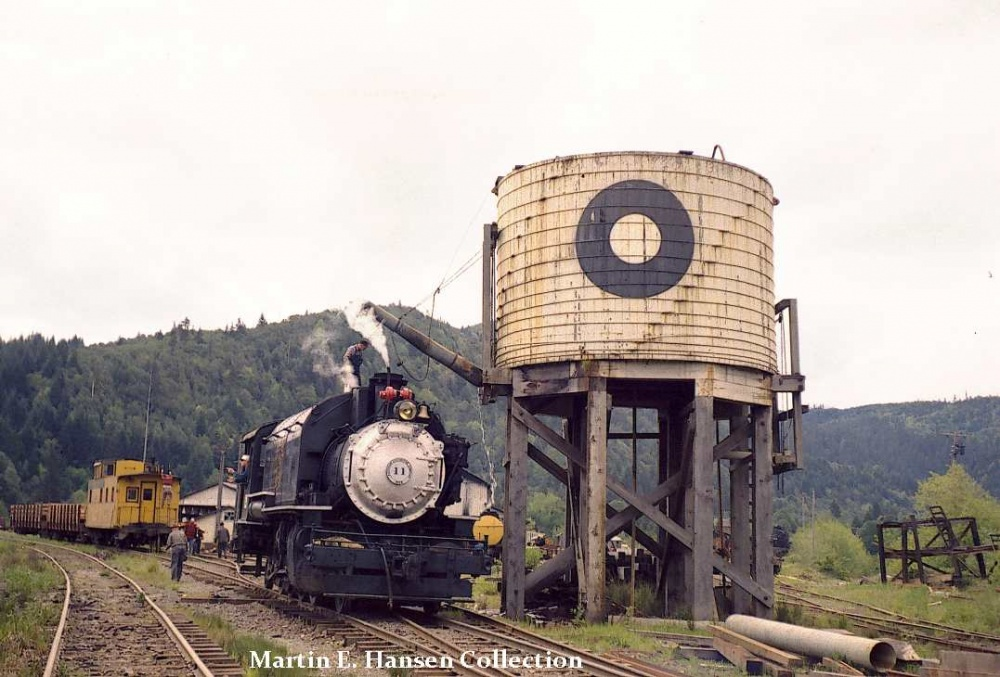 On May 7 of 1961, Coos Bay #11 takes on water and oil outside the shops at Powers, OR in preparation for taking a group of Boy Scouts on a train ride.  Photo by R. E. Burke - Martin Hansen Collection.