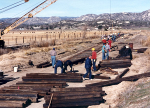 All-volunteer crews laying track from the SD&A main line to the new shop building