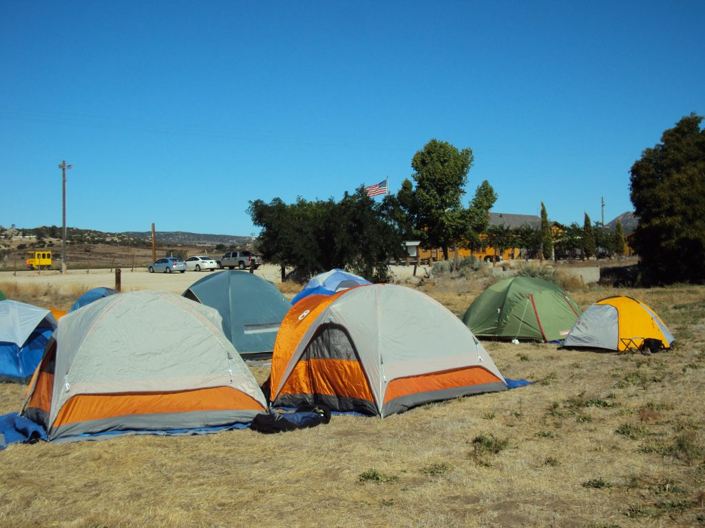 Scouts from Troop 959 pitch their tents just a few steps away from the historic Campo Depot, built in 1917